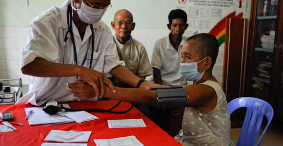 A Doctor at Sya Health Center in Sampov Meas, Pursat Province, meets with one of many patients